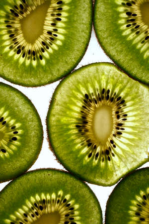 light shining through some fresh kiwi fruit