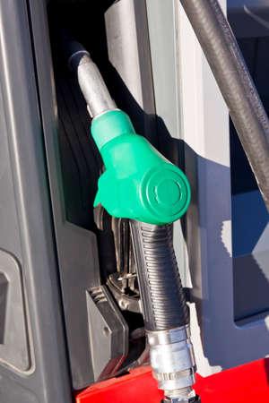 green handle petrol pump depicting an unleaded fuel or gasoline