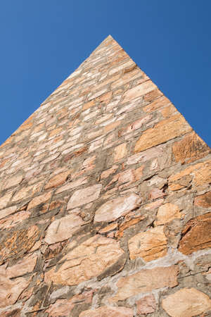 corner perspective of a stone pyramid at the Donkin reserve in port Elizabeth South Africa with blue sky and copy space Stock Photo