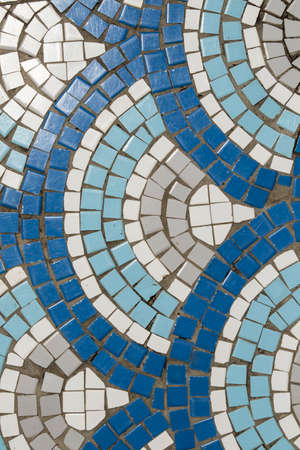 large semi circle mosaic patterns with blue and white squares in open air