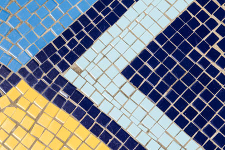 mosaic patterns of triangle shapes made with square blocks of yellowand different shades of blue