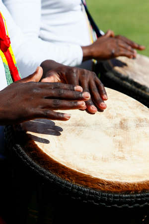 African mans hands playing a djembe drum during a festival  Stock Photo