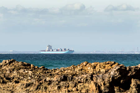 Large container vessel anchored in Nelson Mandela bay waiting to offload its cargo Stock Photo - 92788432