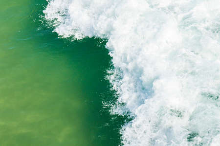 Beautiful braking wave with white water and aqua marine coloured water underneath Stock Photo