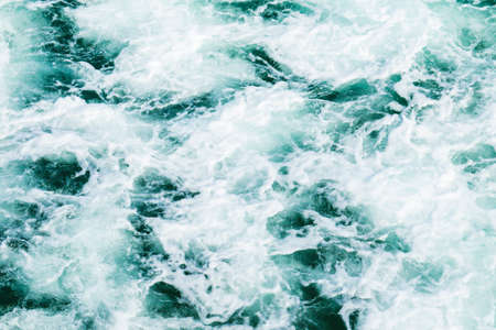 dramatic wave action after a wave has broken with dark blue colours and white water Stock Photo