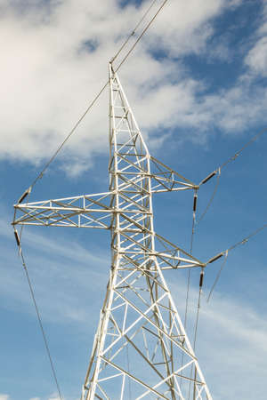 High voltage power lines being held apart by a steel tower structure