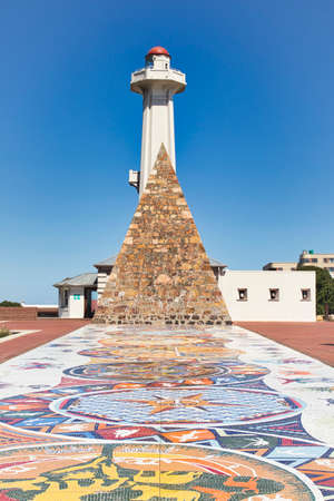 Donkin reserve in Port Elizabeth south Africa showing mosiac tiles in the foreground and lighthouse in the background Stock Photo