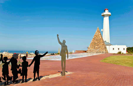 Wide angle view of a Nelson Mandela metal cut out at the Donkin reserve in port elizabeth south africa