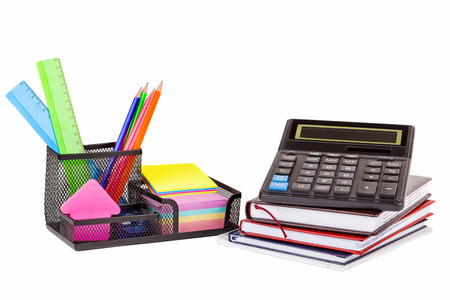 Stationery isolated on white. Notebooks, markers, pencils, rulers, stickers, stapler, calculator
