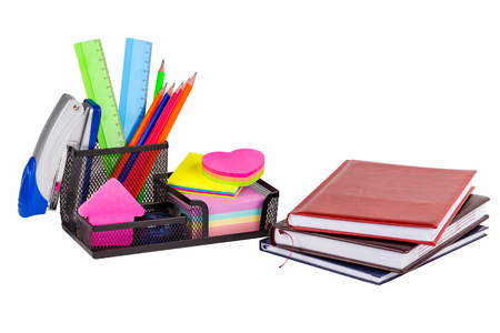Stationery isolated on white. Notebooks, markers, pencils, rulers, stickers, stapler