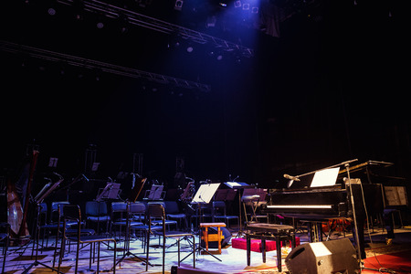 Vinnitsa,Ukraine - December 13,2015.Empty chairs stand on stage in Concert Hall. Piano on stage. Scene symphony concert hall.European scene, a concert of symphonic music Editorial