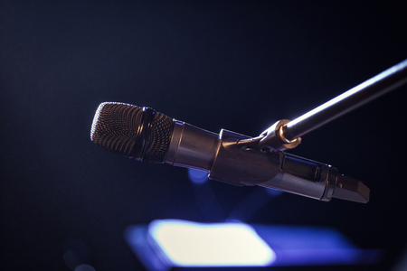 Microphone. Classic microphone. A microphone on stage. A pub. Bar. Restaurant.Scene. Evening. Night show. European restaurant, bar. American restaurant, bar.Concert hall Stock Photo