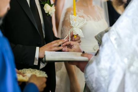 newlyweds exchange rings, wedding rings on a wedding ceremony in the church,wedding ceremony, glans Stock Photo