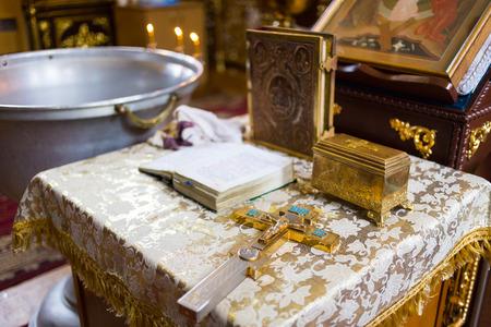 church utensil on an altar, wedding ceremony, glans, cross on the church altar,the Bible on the table