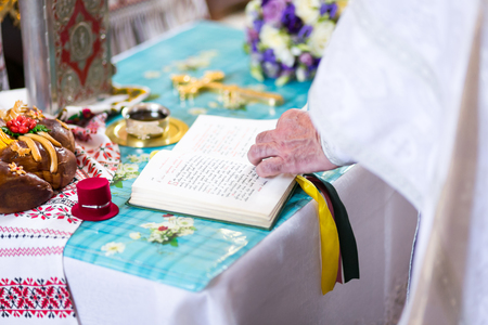 church utensil on an altar, wedding ceremony, glans, bridal bouquet, the priest says a prayer in the church, Stock Photo
