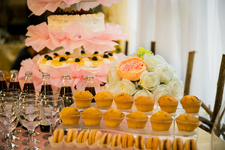 Candy Bar. Delicious sweet buffet with cupcakes and macaroons. Sweet holiday buffet with cupcakes and other desserts.Table with sweets, candies, dessert,happy birthday concept Stock Photo