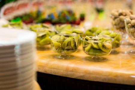 kiwi buffet, stylish luxury decorated candy bar for the celebration of a wedding, Fresh delicious kiwi  on the buffet table