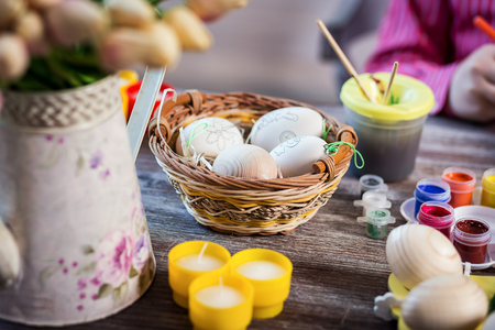 eastertime: Easter decor,colouring eggs for eastertime at home.Happy easter! Happy family preparing for Easter.decorating Easter eggs