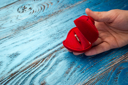 The offer to get married. A gift for St. Valentine's Day. Marriage proposal.