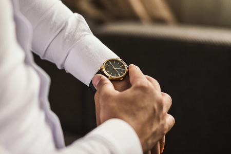businessman checking time on his wrist watch, man putting clock on hand,groom getting ready in the morning before wedding ceremony Stok Fotoğraf