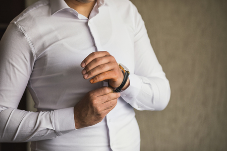 businessman checking time on his wrist watch, man putting clock on hand,groom getting ready in the morning before wedding ceremony Reklamní fotografie