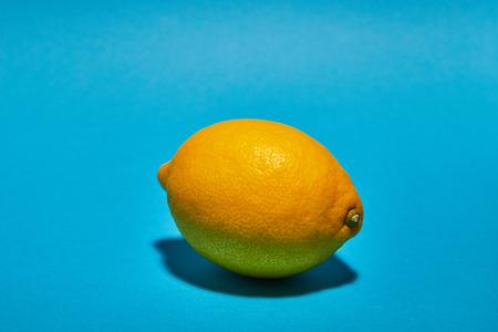 Lemon on blue background. Ð¡opy space . Food concept.