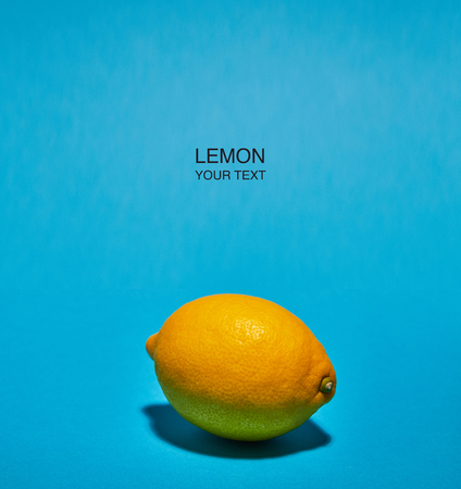 Creative layout made of lemon on blue background. Copy space . Food concept.