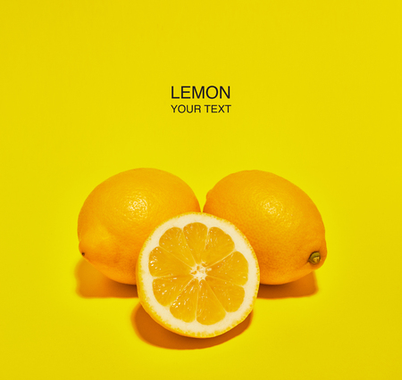 Creative layout made of lemon on yellow background. Copy space . Food concept.