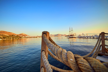 Beautiful sea landscape with tourist ships on the background in Bodrum, Turkey. Vacation Outdoors Seascape Summer Travel Concept