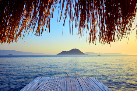 Bungalow on the sea at sunset. Wooden pavilions on the shore of a sandy beach - Bodrum, Turkey Stock Photo