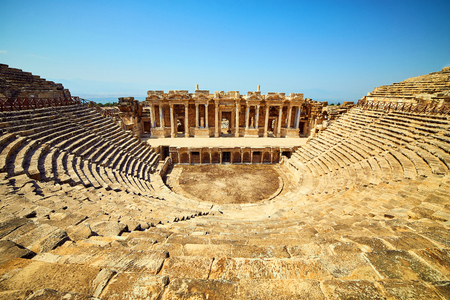 Ruins of old amphitheater, Hierapolis in Pamukkale. Is popular tourist destination in Turkey. Panorama ancient Greco Roman city