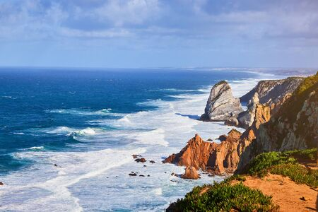 Cabo da Roca, Portugal. Lighthouse and cliffs over Atlantic Ocean, the most westerly point of the European mainland. 版權商用圖片