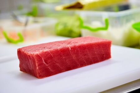 Steak of Tuna Fish Fillet on a cutting board - Fish and Seafood