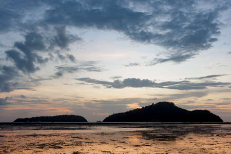 as far as the eye can see: Before Sunrise on the island, tide down the beach as far as the eye can see, silhouettes.