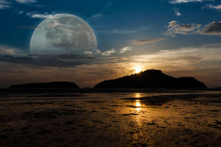 as far as the eye can see: Super Moon, Sunrise on the island, tide down the beach as far as the eye can see, silhouettes. Stock Photo