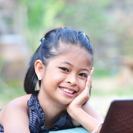 Little asian girl with laptop Stock Photo - 17445945