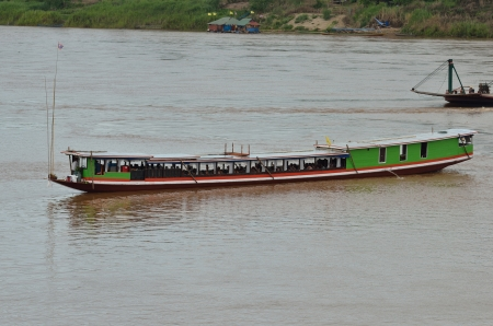 long tailed boat: HOUAY XAI HARBOR,BOKEO,LAO PDR – JUNE 10 ; Unidentified passenger ship takes the tourists from Luang Prabang to Bokeo on June 10,2013 at Houay xai harbor, Bokeo , Lao pdr