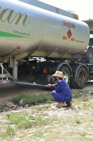 avian: HOUAY XAI HARBOR,BOKEO,LAO PDR � JUNE 10 ; Unidentified man is spraying chemicals against  Avian influenza   H7N9  at Houay xai harbor, Bokeo , Lao pdr on June 10,2013