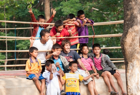 MAE SOT,TAK,THAILAND-APIRL14;Unidentified burmese children pose for photo at outdoor boxing ring near Mae sot international check point  Thailand-Myanmar border during Songkran festival on Apirl 14,2013,Mae sot,Tak,Thailand