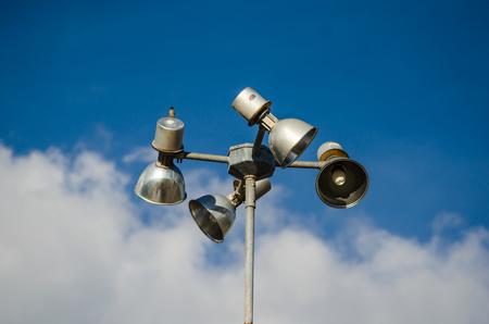 Spot-light tower ,blue sky background  photo