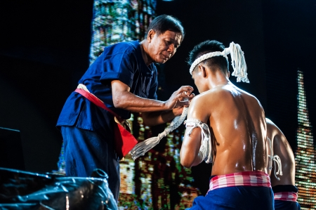 unrivalled: AYUTTHAYA,THAILAND -FEBRUARY 23 ; Dr Jarusdej Ulit the senior  grand master  Mongkol9  of the Kru muay thai assosiation in   The World s Unrivalled Fight  on February 23, 2013 Ayutthaya,Thailand Editorial