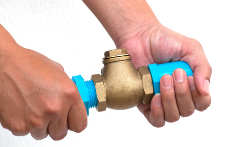 Bronze swing check valve and pvc pipe connection on hands  photo
