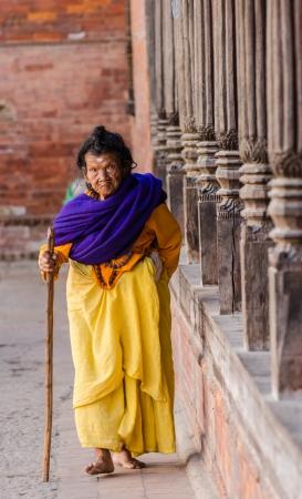 KATHMANDU, NEPAL - DECEMBER 04  An elderly woman walks in the Social welfare center Briddhashram  Elderly s home  on December 04, 2013 in Kathmandu, Nepal