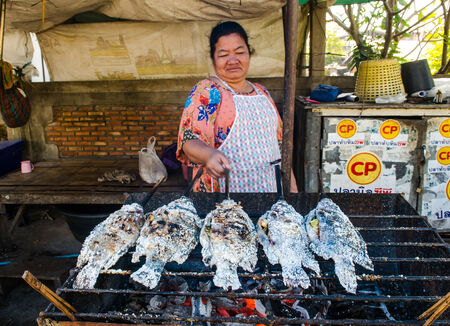 UBONRATCHATHANI, THAILAND - JANUARY 15 ; An Unidentified salted fish grilled mongers on a street open market ,January 15,2014 ,Ubonratchathani,Thailand