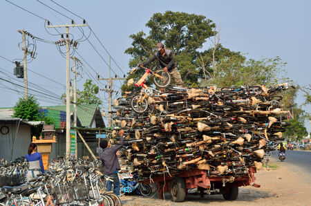kap: KAP CHOENG,SURIN,THAILAND-MARCH 19 ; Unidentified labours are taking the second hand bicycles to the bicycle shop at thai-cambodia s border ,March23,2014,Amphoe Kap Choeng,Surin,Thailand