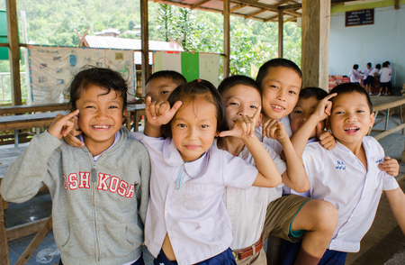 BAAN MAE- OR  , MAE CHAEM, CHIANGMAI, THAILAND, JUNE 10   Unidentified Karen ethnic kids  are showing  call me  sign at  their primary school   on June 10,2014 Mae chaem,Chiangmai,Thailand