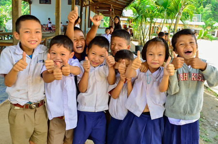 BAAN MAE- OR , MAE CHAEM, CHIANGMAI, THAILAND, JUNE 10   Unidentified Karen ethnic kids are showing thumbs up sign at their primary school  on June 10,2014 Mae chaem,Chiangmai,Thailand