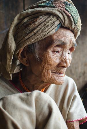 BAAN MAEYOT ,MAE CHAEM,CHIANGMAI,THAILAND - MAY 28 ; Portrait of a very old Karen tribe woman sitting at her home on May 28,2014 in Bann Maeyot,Mae Chaem Chiangmai,Thailand