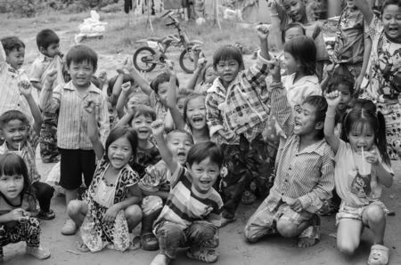 kap: KAP CHOENG,SURIN,THAILAND-JULY 20  A group of happy Khmer kids are playing while their parents are working at  Chong Jom market  Thai-cambodia border   on July 20,2014 in Kap Choeng, Surin,Thailand