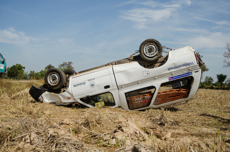 highway 3: SISAKET,THAILAND - JANUARY 3 : Rescue car  overturned  on January 3, 2015 at the Highway 24 on the way from Sisaket to Ubon ratchathani  ,Thailand